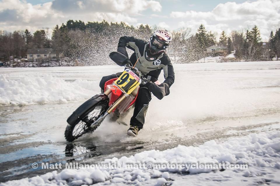 Motorcycle sliding around icy, wet corner