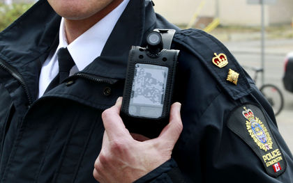 Closeup of body camera on a police officer