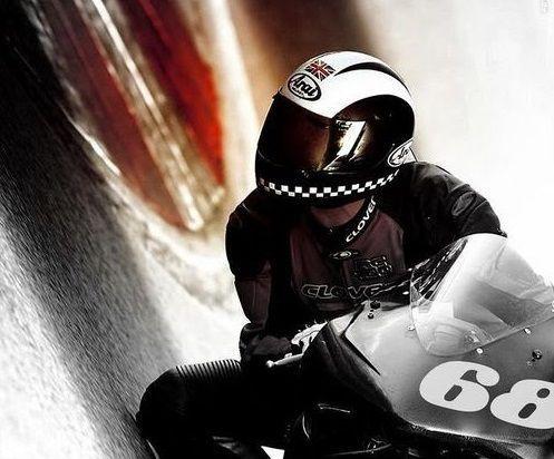 Motorcycle racer inches from ground around sharp corner