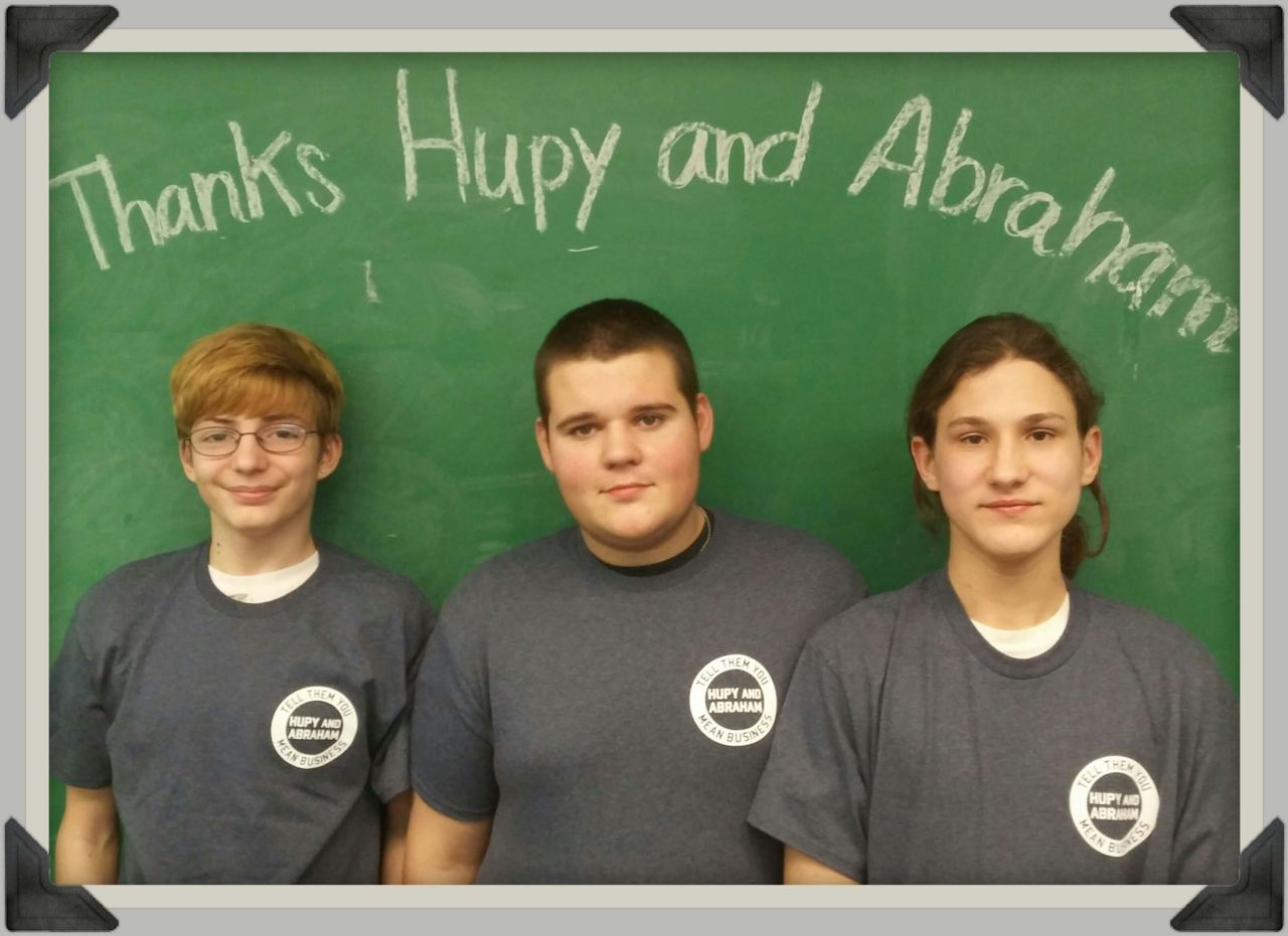 Audobon students pictured with thank you sign for Hupy and Abraham