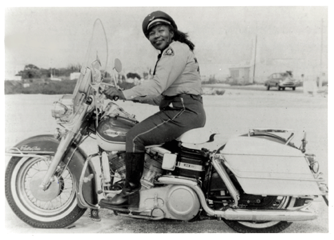 Woman on vintage motorcycle