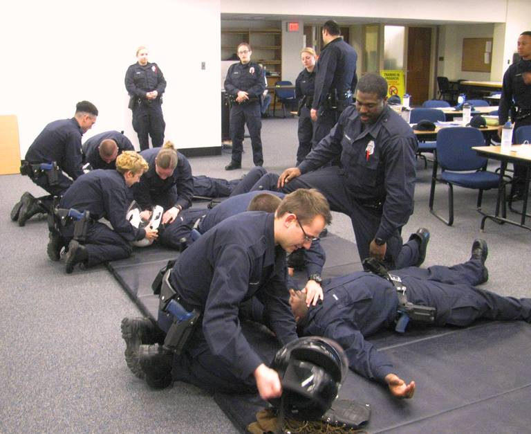 Classroom of police cadets learning to responding to a motorcycle crash