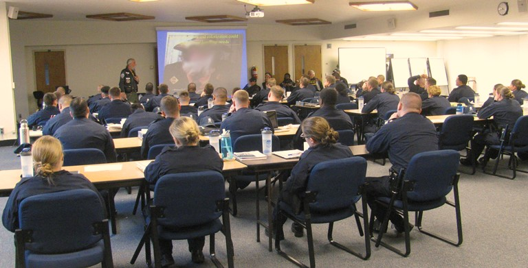 Police cadets watching presentation on responding to a motorcycle crash