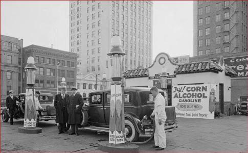Vintage car at gas pump in city