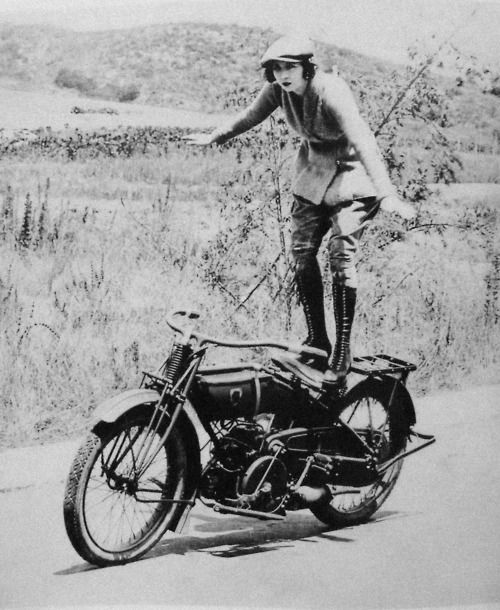 Jamaican native Bessie Stringfield performing stunt on vintage motorcycle
