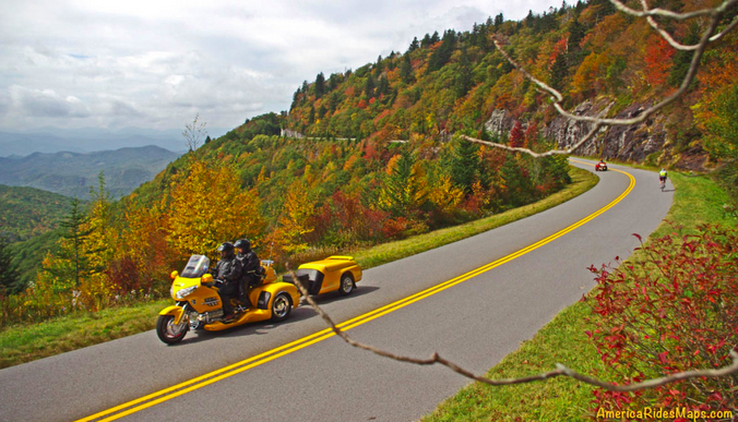 Scenic fall trees and river with motorycle