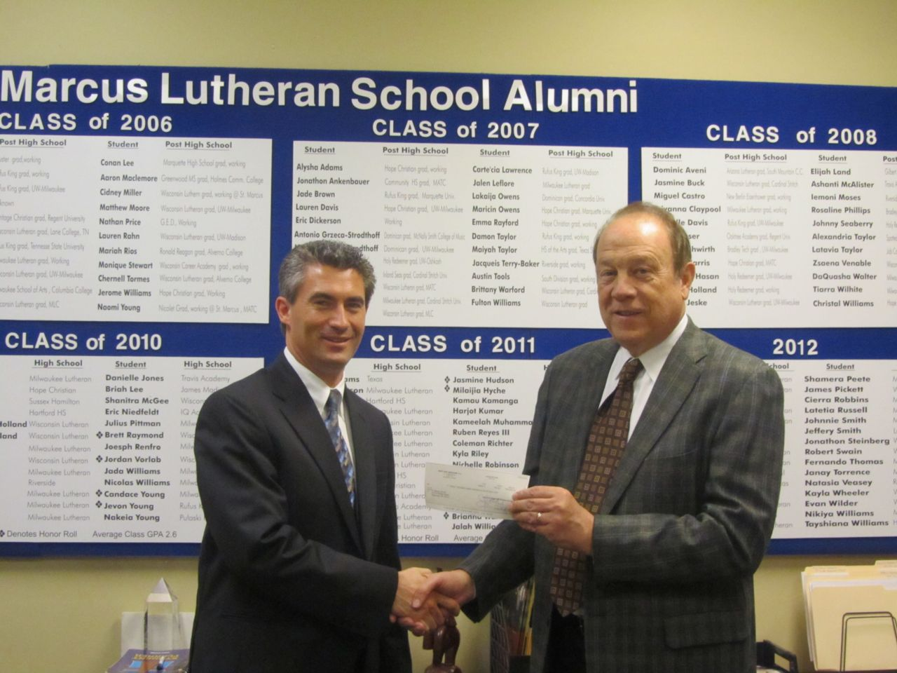Attorney Hupy presenting check to St. Marcus Lutheran School