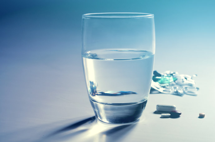 glass of water with medication