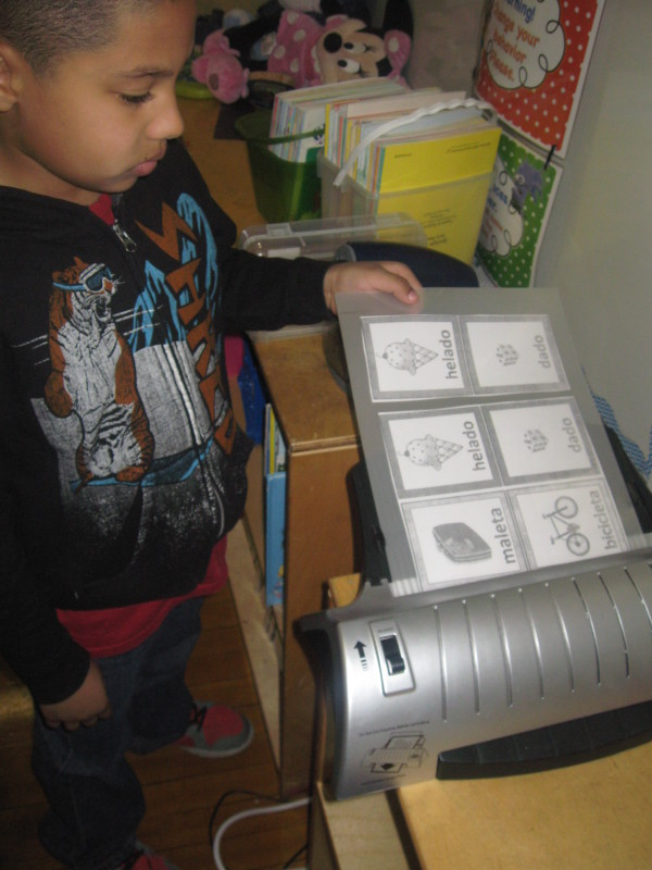Kids using lamination machine donated by Attorney Jason Abraham