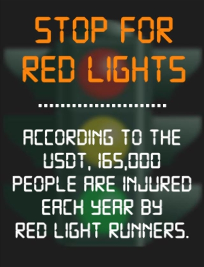 Stop for red lights warning sign - 165,000 people are injured each year by red light runners