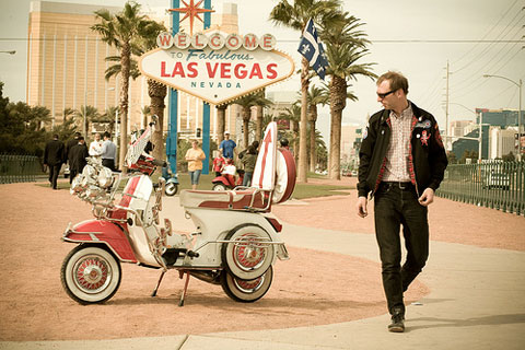 Vintage scooter with Las Vegas sign in background