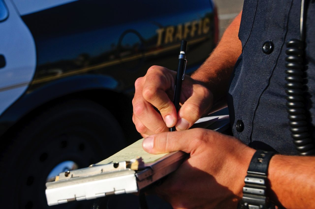 Officer writing speeding ticket