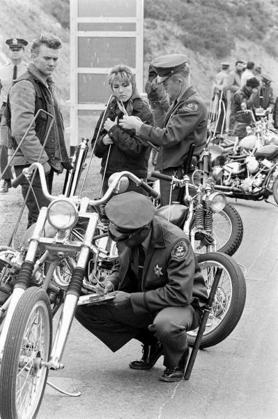 Police officers searching motorcycles