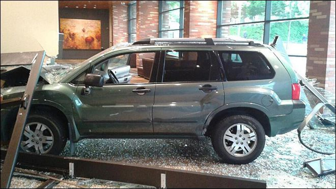 SUV crashes into a hotel lobby