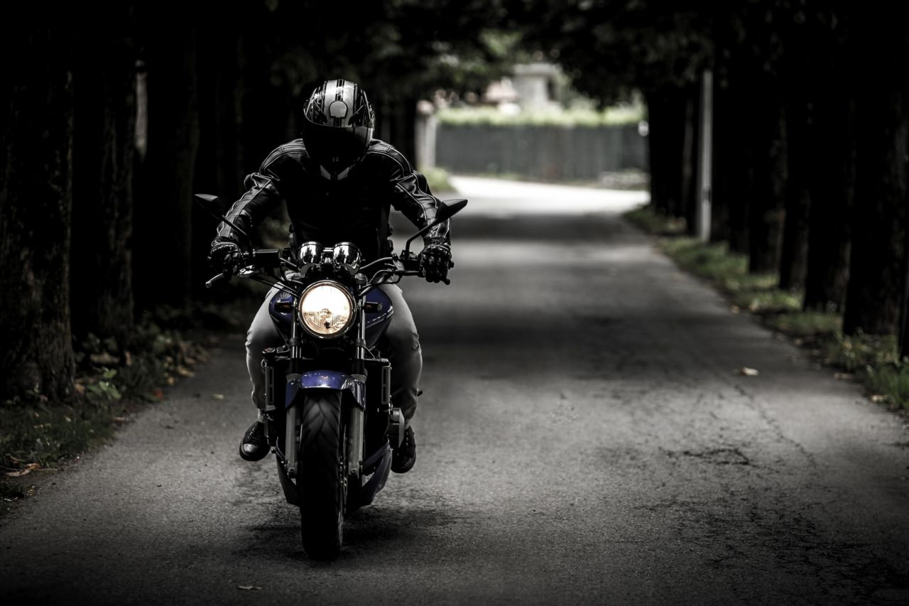 motorcycle on dark road