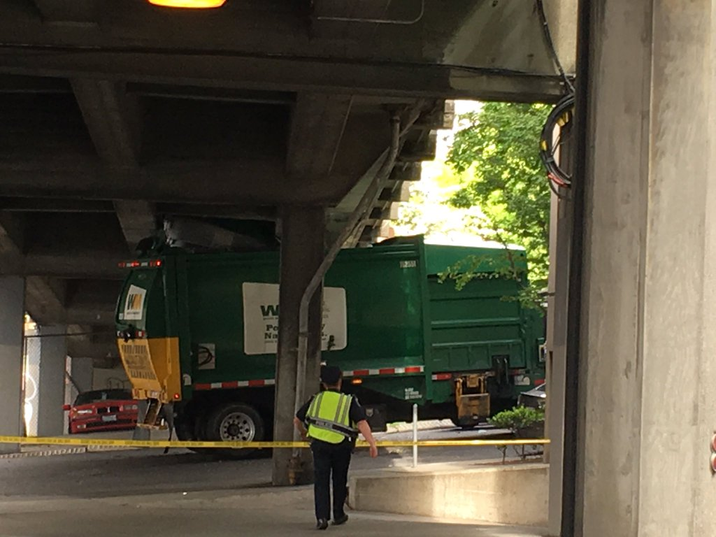 truck stuck under viaduct