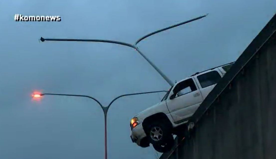 suv dangles off i5 after crash