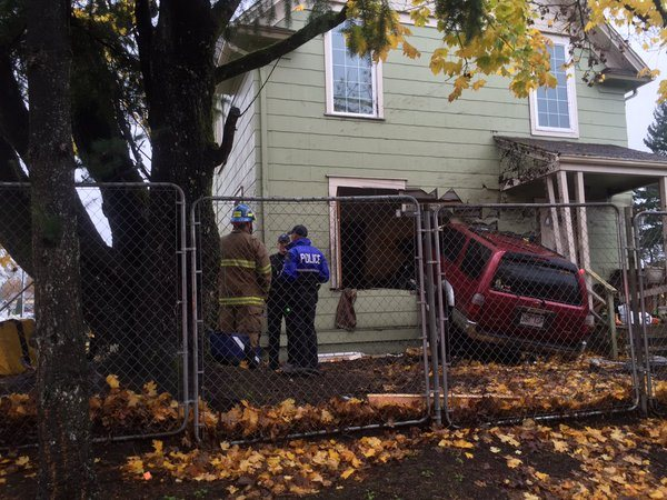 suv crash into building