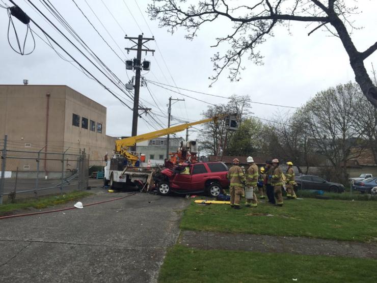 tacoma utility truck crash
