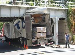 truck hits bridge