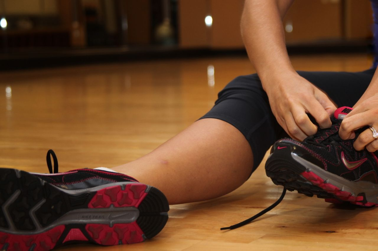 Runner tying shoes for physical activity