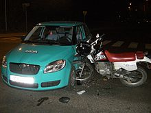 Car turned in front of a motorcycle crash