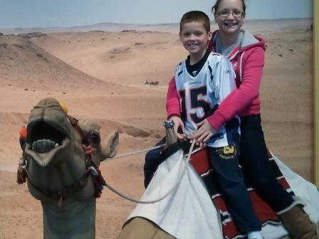 Sophie and Corbin on Camel at Des Moines Science Center