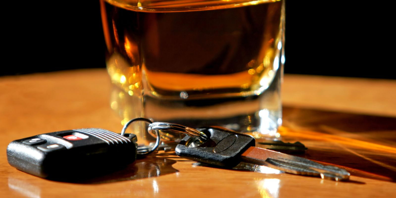 Car Keys next to alcoholic drink for drinking and driving