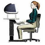 woman sitting at desk with proper posture
