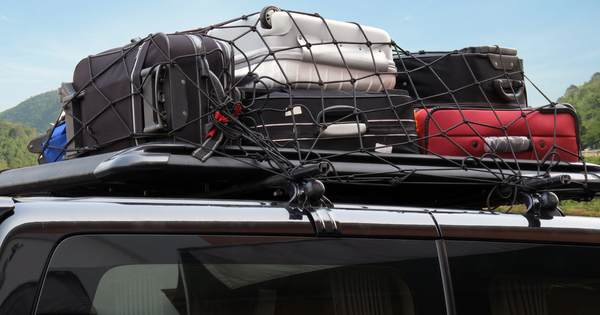 Luggage stored on roof of suv