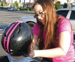 Kati Fitting a Bicycle Helmet