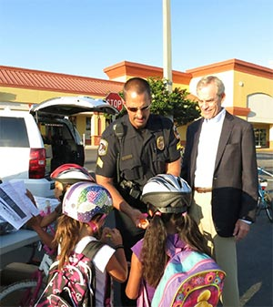 Clearwater personal injury attorney Jim Dodson and local police participating in the Bikes for Kids initiative.