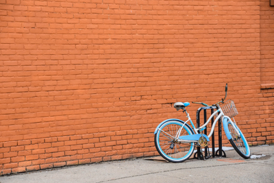 Bicycle leaning against a brick wall