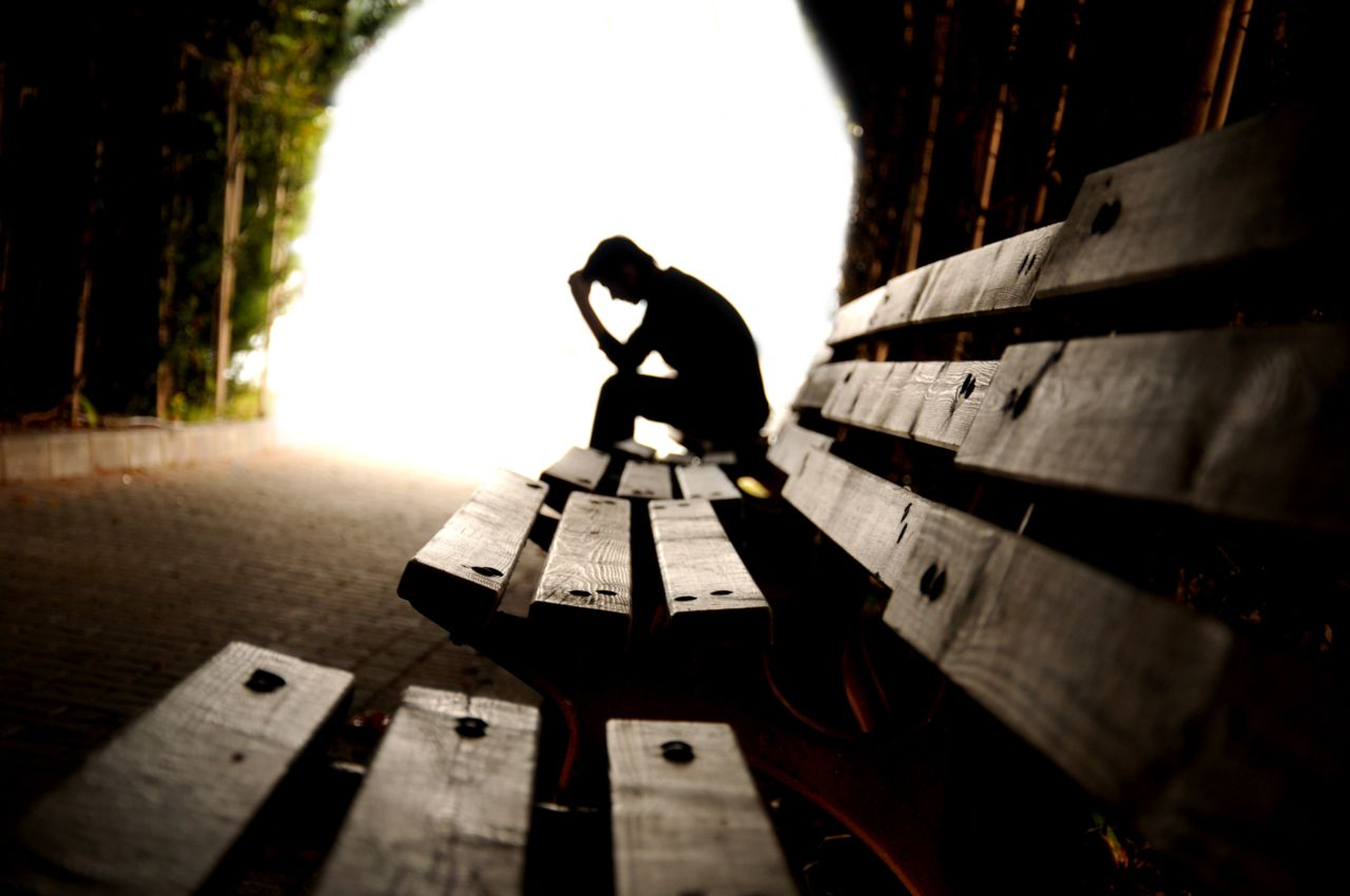Someone Sitting on a Bench Who Appears Depressed