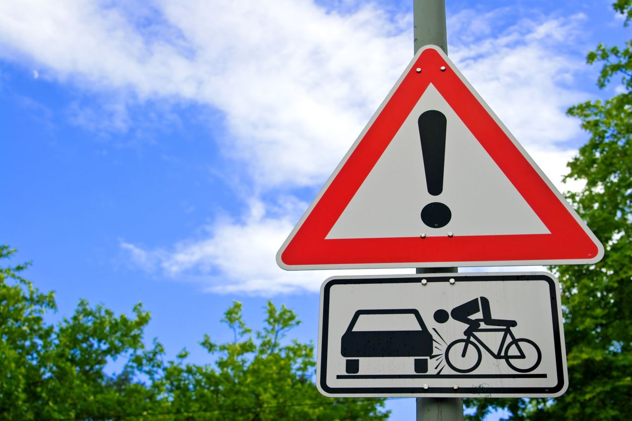 Street Sign of a Cyclist Hit By a Door