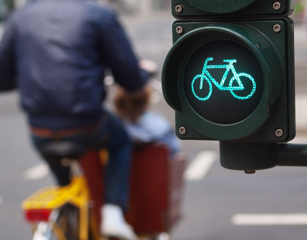 Cyclist Crossing the Street on Green