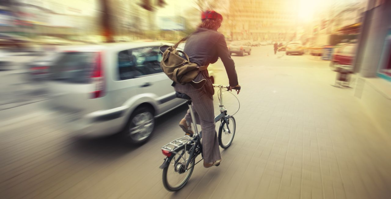 Car Passing a Someone on a Bicycle