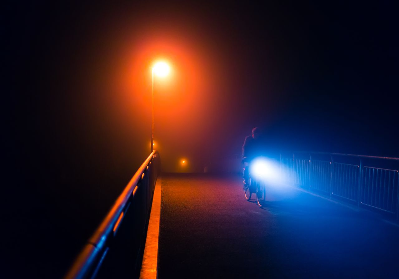 Cyclist Riding at Night