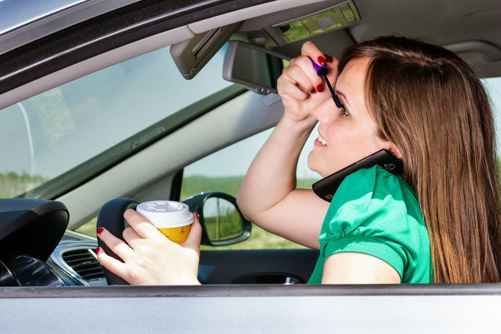 Girl Putting on Makeup While Driving