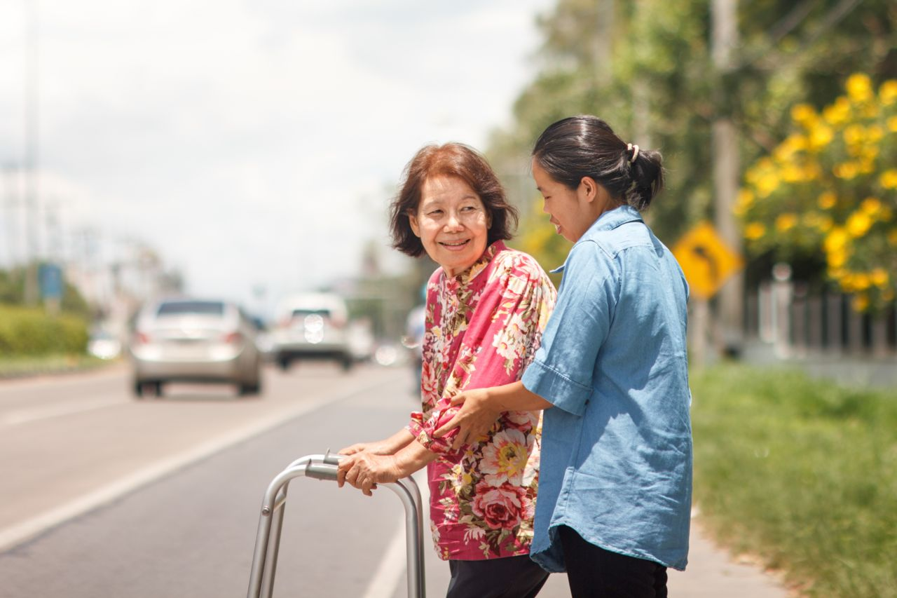 Older Pedestrian Being Helped Crossing the Street