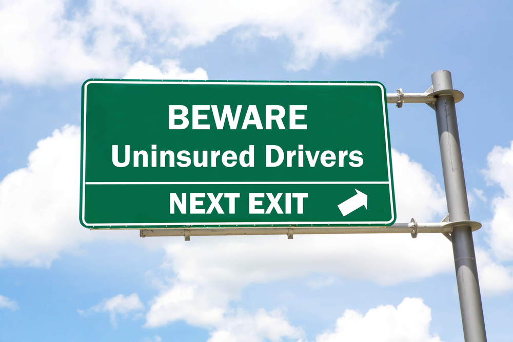 Beware of Uninsured Drivers Highway Exit Sign