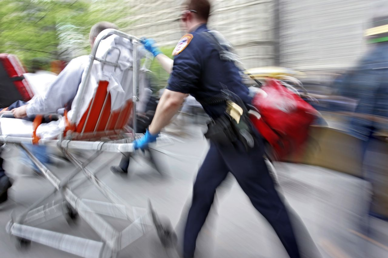 EMT Taking Wheeling Injured Person Into the Hospital