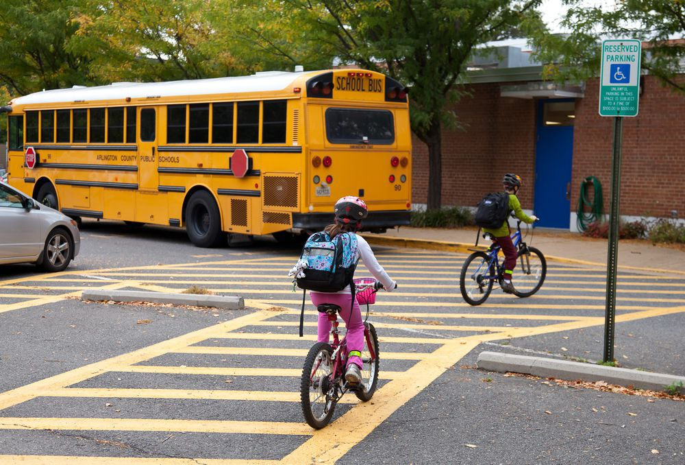 Children Riding Bikes Across a School Crosswalk