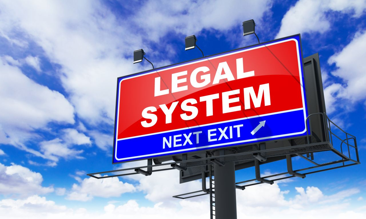 Exit Highway Sign that Says Legal System