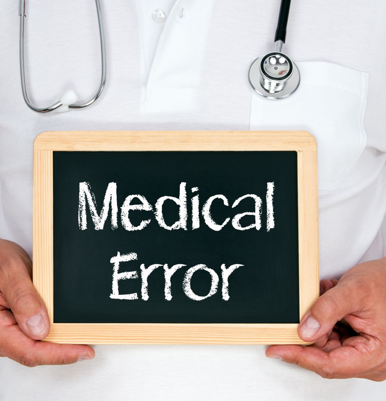 Doctor Holding a Sign that Says Medical Error