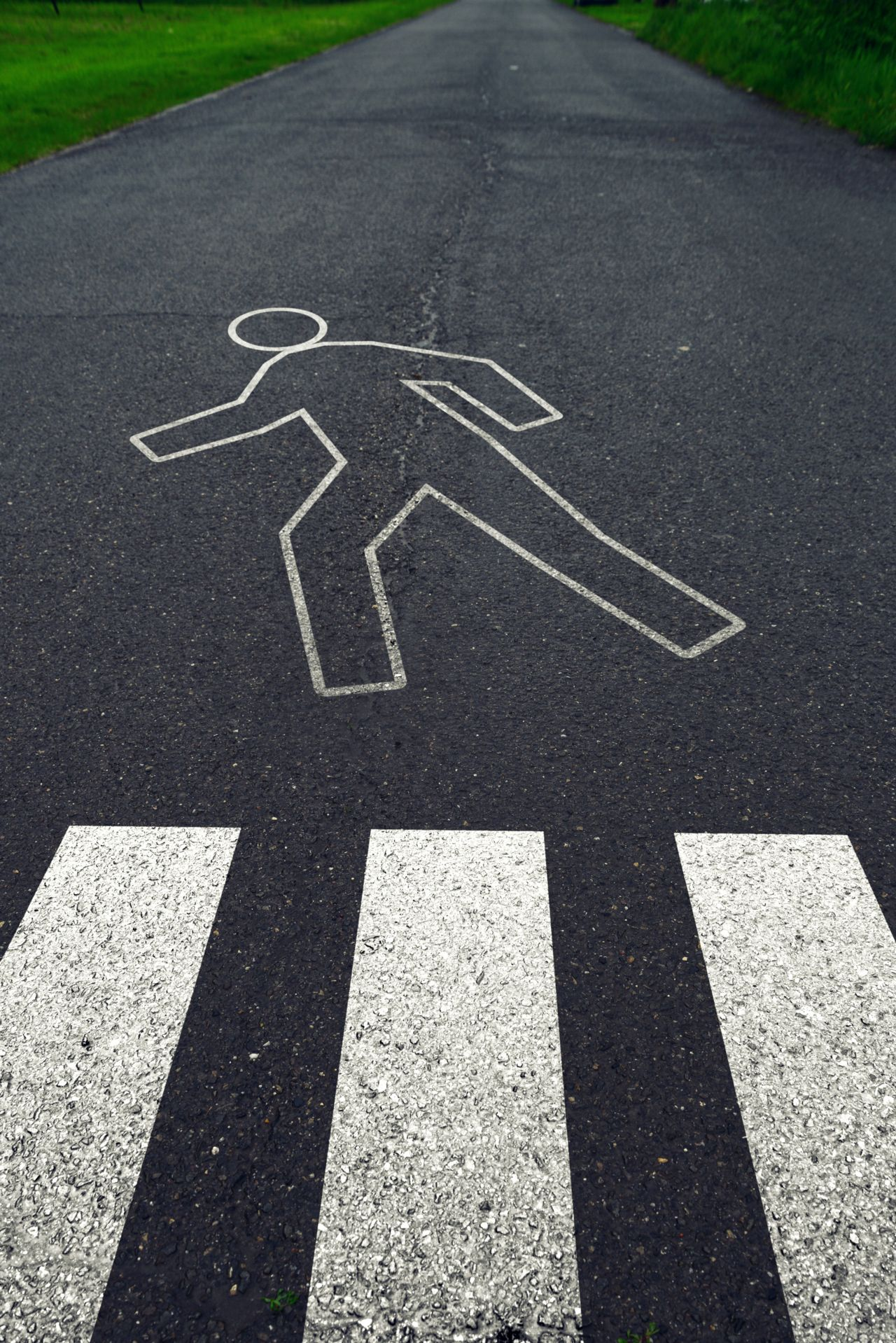 A Chalk Drawing on the Road of a Pedestrian Walking