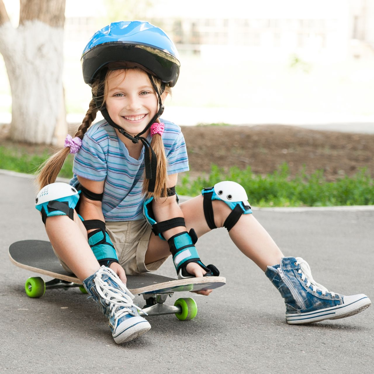 Kid Wearing a Helmet on a Skateboard