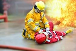 Firefighter Tending to a Fallen Firefighter