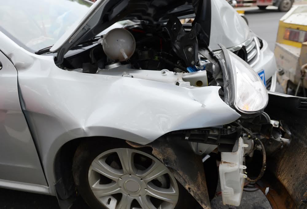 crumpled car in crash