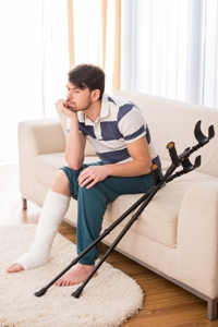 Man with broken leg and crutches